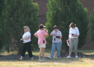 Teachers using GPS devices.
